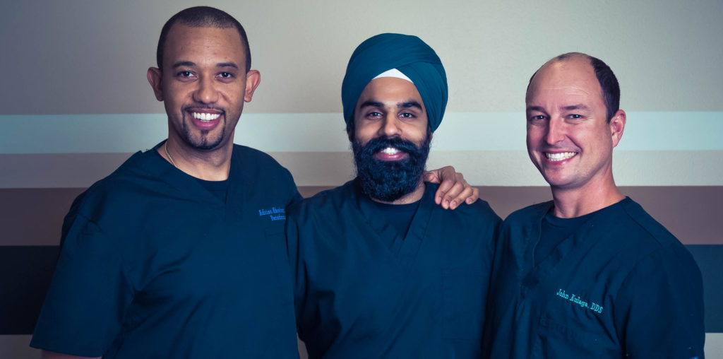 Drs. John Kulaga, Adrian Abrahams, and Jaspreet Parmar lead the highly skilled team at White Wolf Dental in Port Orange, FL